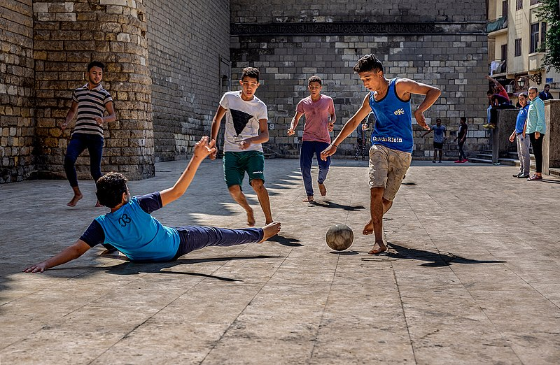 800px-Boys_playing_street_football_in_Egypt
